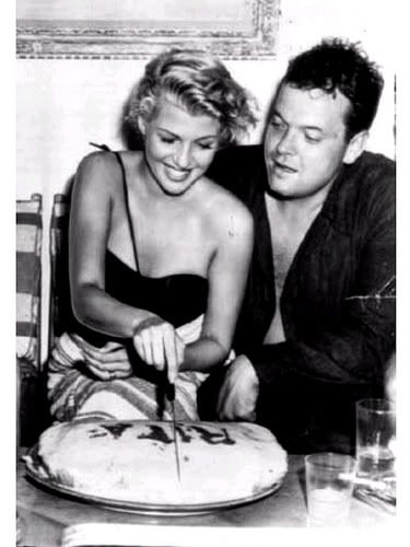 Orson Wells and Rita Hayworth celebrate the beautiful starlet's birthday aboard Errol Flynn's yacht.}