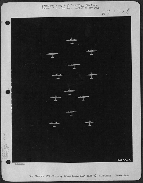 """5th Bomb Group B-24 Liberators, known as the """"Bomber Barons"""" over Balikpapan,Borneo,Netherlands East Indies in July 1945."""