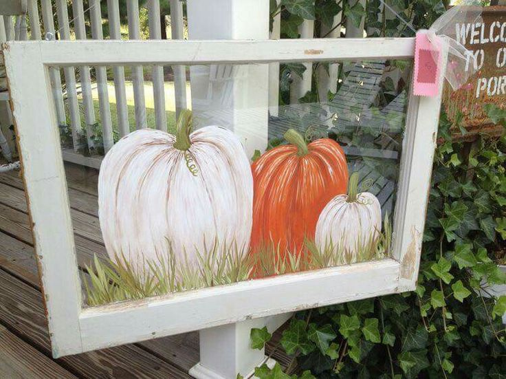 Painted pumpkins on a window