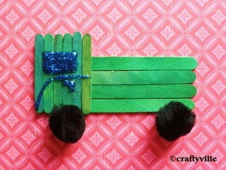 Truck craft for children. Made with popsicle sticks and pom poms. #kidscraft…