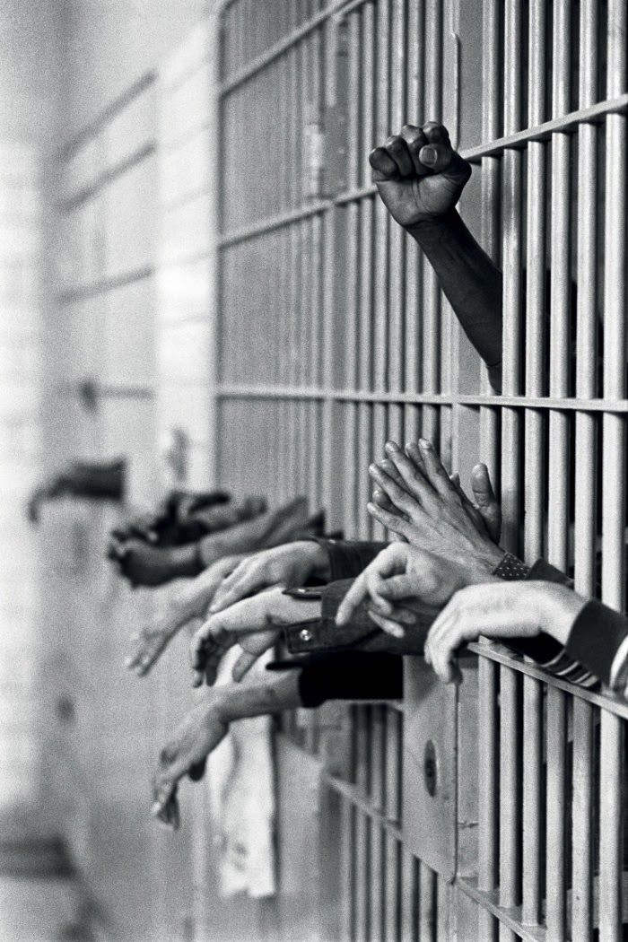 A fist raised in protest from behind the bars at Toms Prison, Manhattan, on 28 September, 1972. Legendary photojournalist Jean-Pierre Laffont captured the changing times of New York City, covering everything from free love to the grim and gritty '70s.