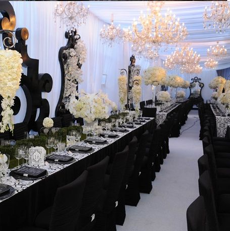 Love the black chairs against black table cloths with a little hint of silver. Also the black frames against the white.