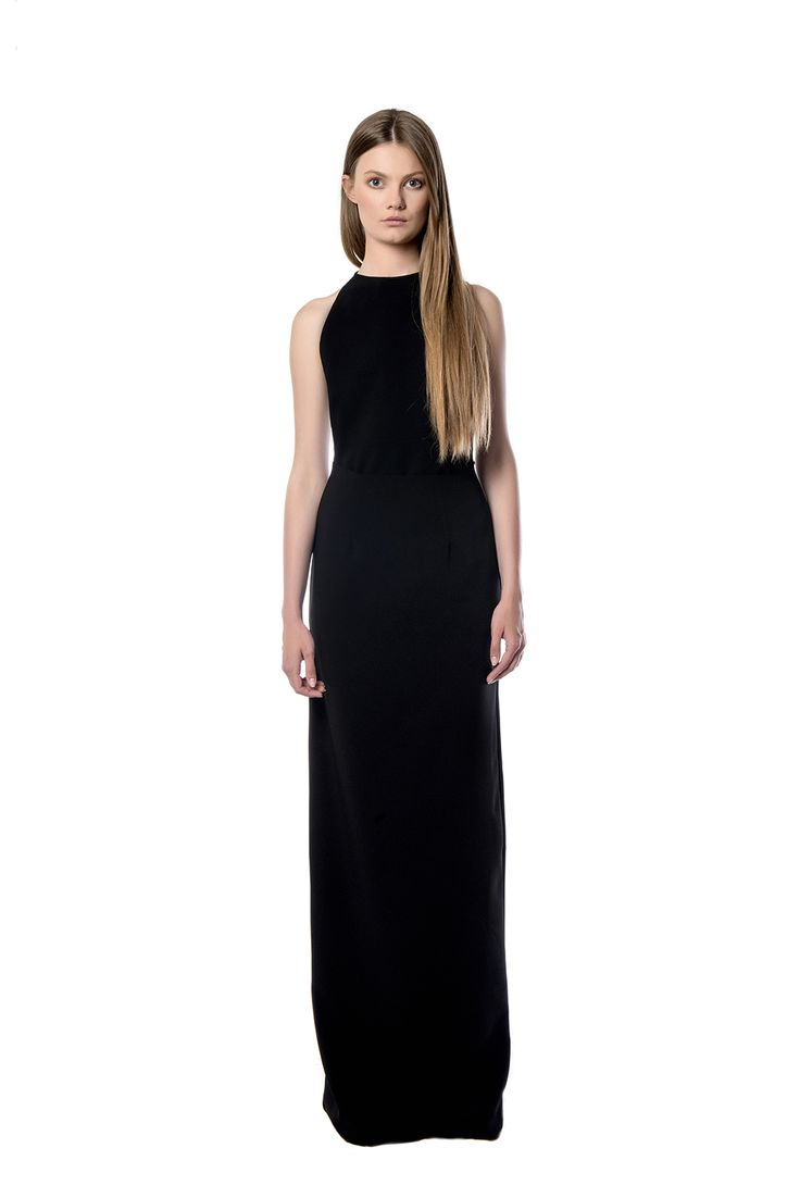 Maxi black dress with open back  This maxi black dress is cut for a close and flexible fit and has an open back. This flattering design fitted through the body and flared gently at the hips, is made out of crepe material. The design is stunning in its simplicity. Complement the style with tonal accessories.