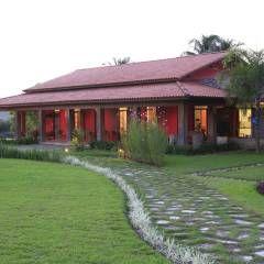 Casa Vermelha: Casas translation missing: br.style.casas.campestre por Andréa Calabria Arquitetura