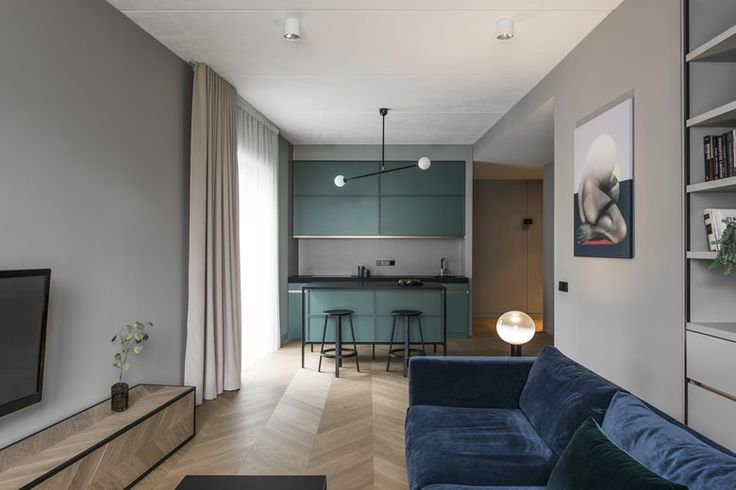 AKTA designed a refined and decorative interior. Monochrome background enhances rich colours and allows the artworks to stand out. Cold grey tones are balanced by velvet fabrics which also make a contrast to the textured ceiling. #openspace