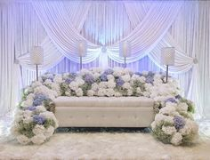 """""""White, blues and greens for Adlina's engagement with a combination of fresh and artificial flowers. Email us: chentaweddings@gmail.com #pelamin #dais…"""""""