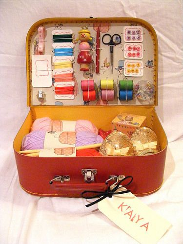Sewing kit from a small repurposed suitcase.
