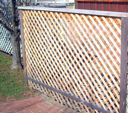 This lattice fence photo shows what this type of inexpensive fencing looks like. To create more of a visual barrier, grow vines on it (as if it were a trellis).