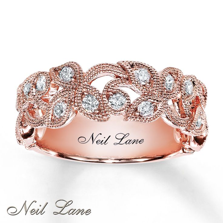Leaves and vines ring of diamonds set in 14K rose gold. Design by Neil Lane.