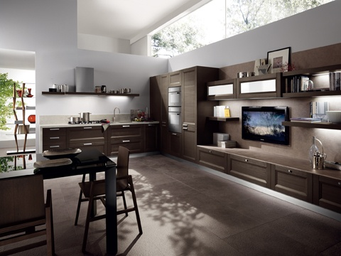 The various solutions available can  be combined – emphasised by sand  Porphyry laminate work-top and  wall cladding for the living -room  composition , or work-top , wall  cladding and end side panel in Grey  Sahara Okite for the coo king zone and sink – to  adapt the Esprit kitchen for a single  room with the same marriage of  functionalit y and relaxation. The  doors are in Slate Tactile Fir-wood ,  with satined nic kel finish handles.  The lo w cabinet is fitted with knobs.