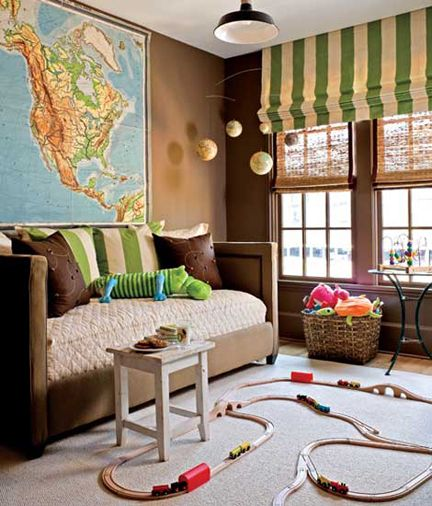 stripped curtains, hanging map and globes, train tracks.  @Amalauna Brock, this is either the perfect room for a little boy or Jonathon.