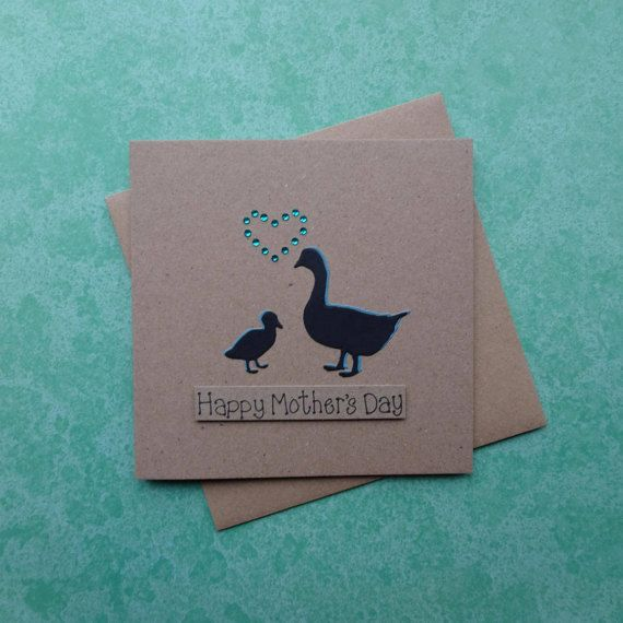 Mothers Day card with Mother Goose and gosling. Mum and baby goose handmade card for Mum / Mom.  This Happy Mothers Day goose card uses recycled Kraft card and has a Mother and child goose with gems in the shape of a heart. The colour of the shadow of the geese (birds) and the gems can be selected from the drop-down menu. The sentiment on this Mothering Sunday card is added with 3D foam and reads: Happy Mothers Day  PERSONALISING YOUR CARD: You can choose the colour of the matching shado...