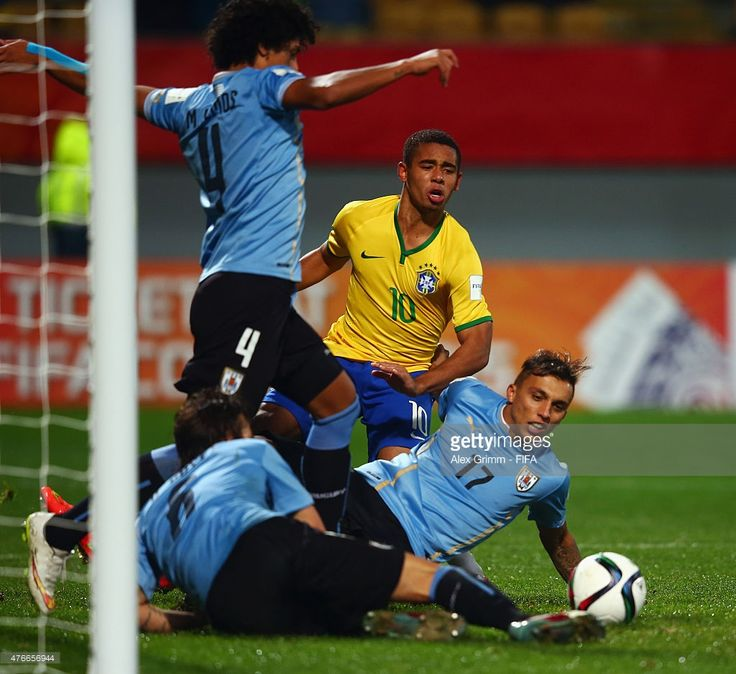 Gabriel Jesus (back) of Brazil is challenged by Mauricio Lemos, Mathias Suarez and Diego Poyet of Uruguay during the FIFA U-20 World Cup New Zealand 2015 Round of 16 match between Brazil and Uruguay at Stadium Taranaki on June 11, 2015 in New Plymouth, New Zealand.