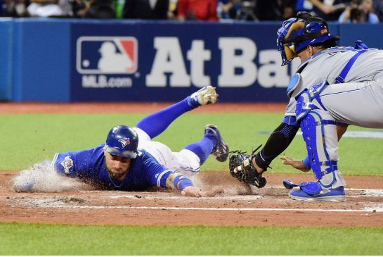 The Jays' Kevin Pillar slides safely into home during second-inning action against the Royals in Game 3 of the ALCS Monday night. Oct 19, 2015
