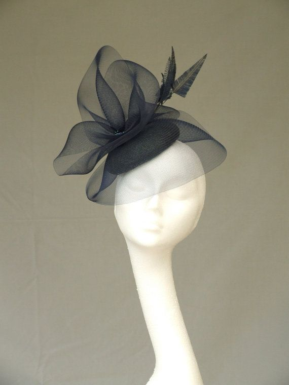 An elegant hand blocked navy sinamay fascinator/headpiece with crinoline and feather detail.  An exquisite way to accessorise for that special