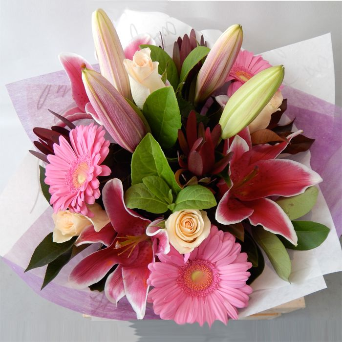 Bouquet with Lilies, roses, gerberas and leucadendrons
