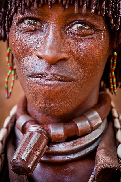 Africa |  Married women of Hamer tribe, show their married status by wearing traditional necklace/collar made out of leather and metal. Only the first wife wears these necklaces.  The other two rings are also a sign that a woman is married, but if she was the second or third, etc wife she only wears the two metal rings and not the top necklace as well. | ©  Ronny Reportage