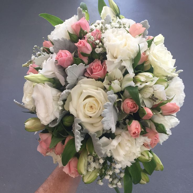 white and soft pink pastel coloured vintage, traditional, structured style bridal bouquet of roses, spray roses, babies breath, alstroemeria, lissies and other mixed flowers. Created and designed by Madison in Bloom Floral Design. www.facebook.com/madisoninbloom www.instagram.com/madisoninbloom www.madisoninbloom.com.au