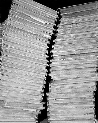 "Abelardo Morell's ""Two Stacks of Bound Newspapers"" - a human spine http://www.abelardomorell.net/photography/books_25/books_48.html"