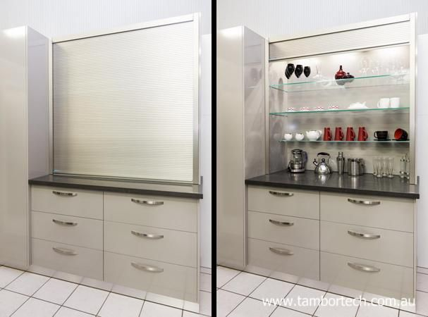 Kitchen design ideas - incorporate a large appliance cupboard using a Tambortech Door to optimise storage space. Great pantry organisation idea.