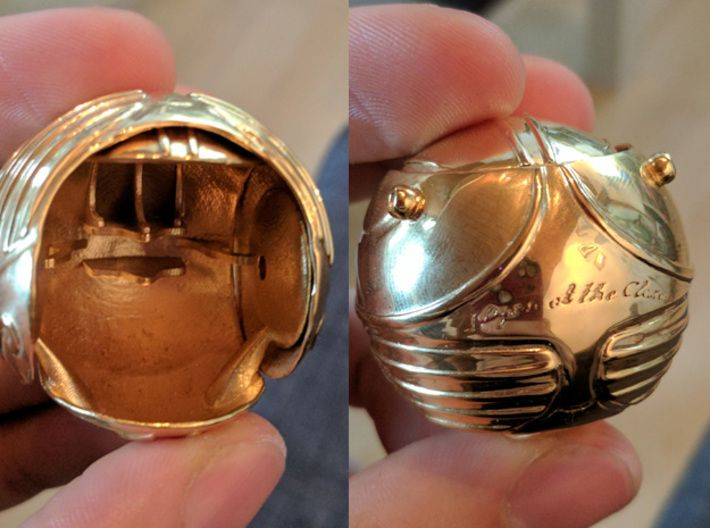 Golden Snitch ring box 3d printed Happy customer photo, 14k Gold Plated. They have it in various materials/colors, the plastic version is a lot cheaper and you could always use metallic spray paint.