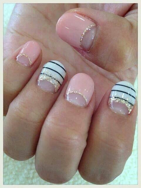 Pale pink with white black and gold accents nail art glitter gel nails
