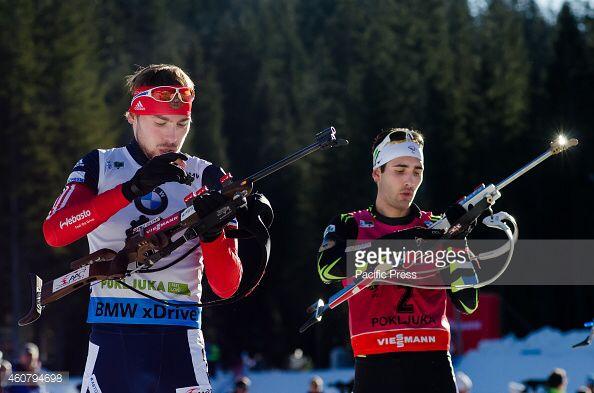 Anton Shipulin and Martin Fourcade at the shooting range during the Mass Start in Pokljuka 2014.