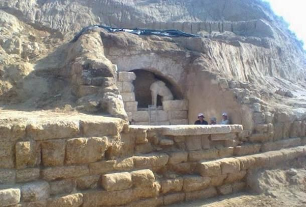 Archaeologists in Greece have uncovered the entrance to a vast ancient tomb guarded by two sphinxes, adorned with frescoed walls, and surrounded by a nearly 500-metre long wall carved from marble, acc