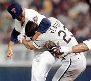 Aug. 4, 1993 - Robin Ventura charges the mound after being hit by a pitch. Nolan Ryan puts him in a head lock while both benches emptied.