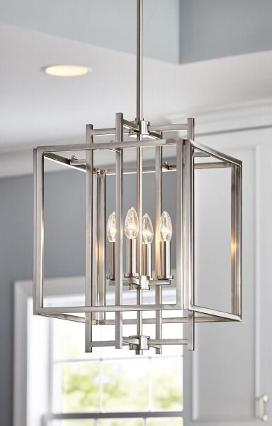 a geometric pendant light in a brushed nickel finish brightens your room with style