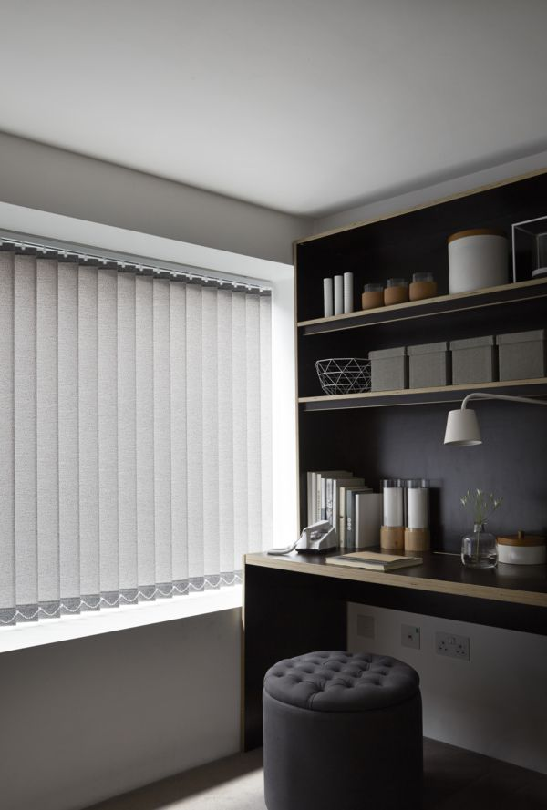 Grey creates a beautiful neutral room, mix different tones and shades to bring depth and texture. Add hints of natural wood tones to bring the look together. Our Pattie Chestnut Vertical blinds add a lovely shade of grey to a room.