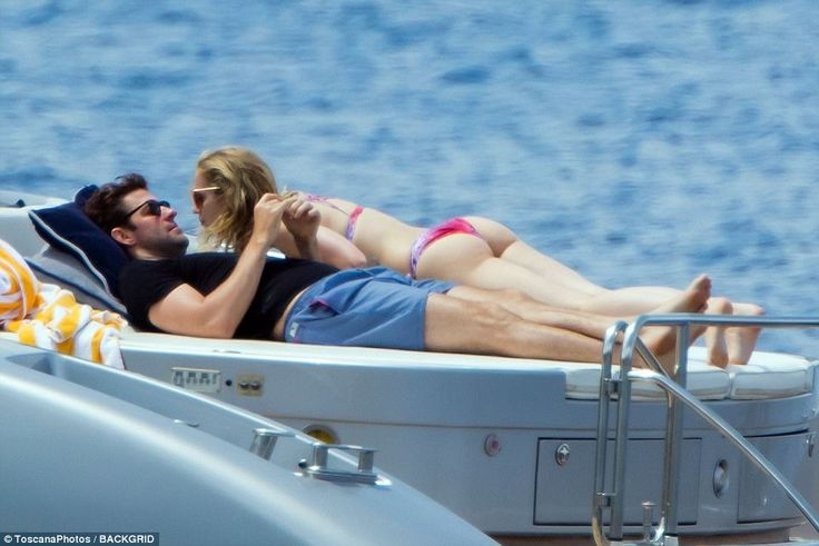 Seas-ing the day: Emily Blunt, 34, and husband John Krasinski, 37, soaked up the sun in Italy while lounging around on a boat before embarking on a spot of shopping