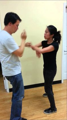 Wing Chun Kung Fu Sticking Hands: the inspiration for the drill from Praise Moon Temple nuns' fighting style. (shameless plug: that's me with my student Ting)