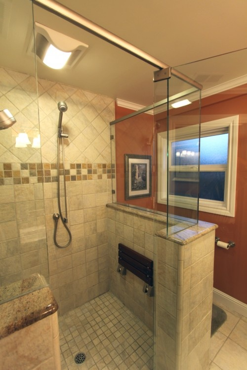 Shower tiles like the fold up down seat rooms to unwind for How to put down tile in bathroom
