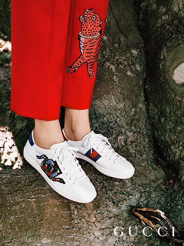 Discover more gifts from the Gucci Garden by Alessandro Michele. The Ace sneaker detailed with a crystal embroidered snake appliqué and House Web stripe.