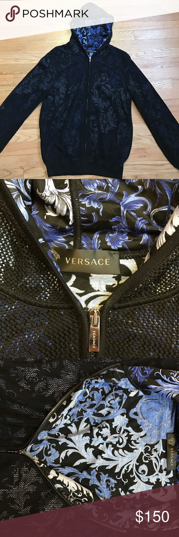 Versace hoodie Excellent like new Versace light weight hoodie. Black fishnet material over silky Versace blue floral design. I am obsessed with this; it's hard to part with this. Price firm Versace Sweaters Zip Up