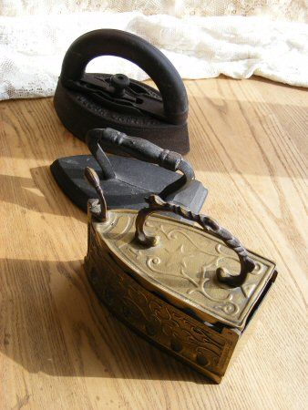 Antique clothes irons. I remember seeing this charcoal filled iron when I was very young. You had to be very careful that the embers do not land on your clothes.
