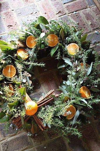 Eucalyptus, rosemary, magnolia leaves and sliced Meyer lemons wreath