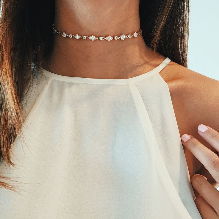 High-necked white tank top with diamond choker necklace