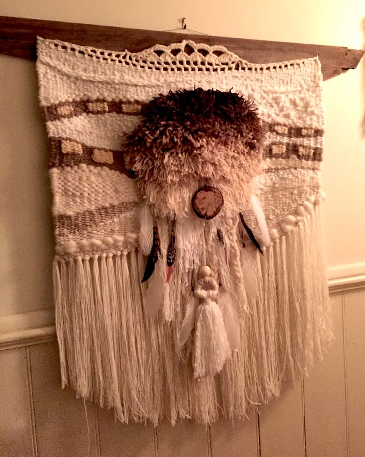 I made this fun piece for my niece - a combination of natural colours and vivid textures. An added boho look with feathers and timber embellishment.