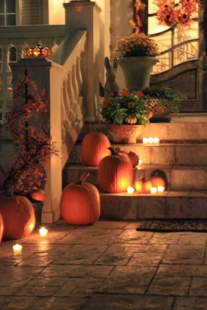 Use (battery operated) candles on your porch with fall decor like pumpkins and mums- looks lovely! via Providence Design #falldecorating