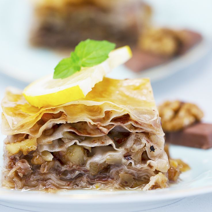 Baklava is a Middle-Eastern dessert, which consists of a rich and sweet pastry made with phyllo sheets, filled with walnuts and topped with syrup and honey. We thought adding some chocolate to the classic recipe can sure cause no harm! If you haven't tried cooking them by now, there are a few tricks involved, but do your best, because in the end it will totally worth it!