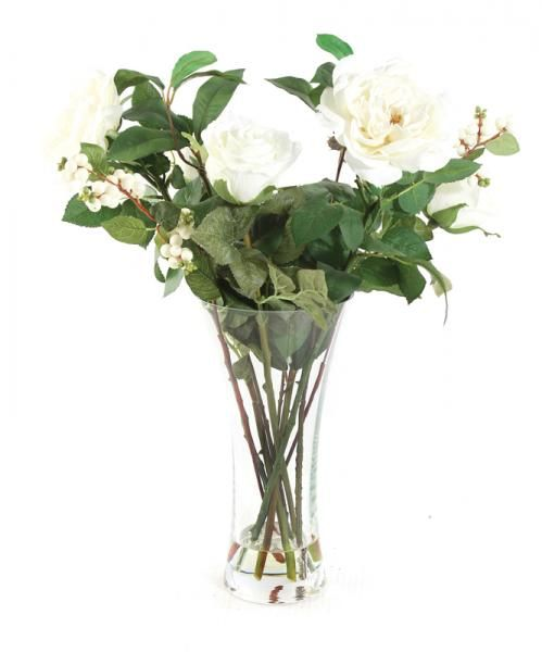 Tall - White Roses and Snowberries in a tall glass vase with foliage, set in Still Water™. Height 55cm. €70.00