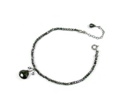 Black Onyx heart shape drop and Spinel beads http://www.mounir.co.uk/collections/soiree/4614_black_onyx_bracelet