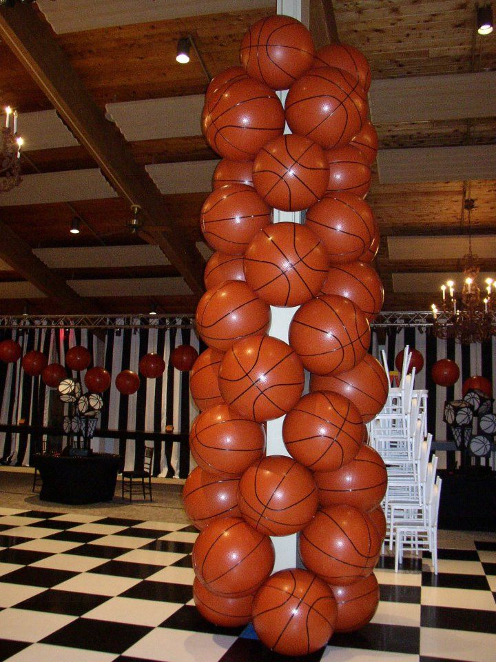 Tower of huge vinyl basketballs covering a support