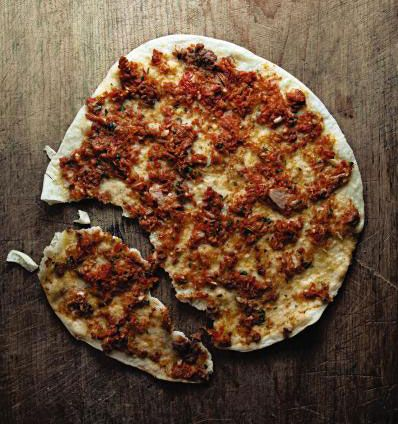 Lahmacun (Flat Bread with Lamb and Tomatoes) ~ Bake these Turkish spiced lamb and tomato flat breads on a heated pizza stone in the oven so that the crust and topping cook evenly.