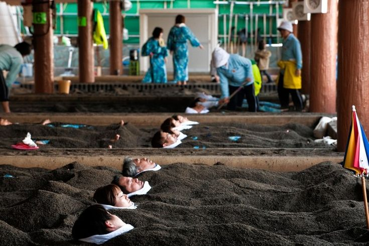 A crowd enjoys a hot sand bath on the beach of the sunamushi onsen in Ibusuki.