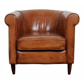Another texture to add to the room and a warm tan colour too. A throw over this would soften the leather to sit on.