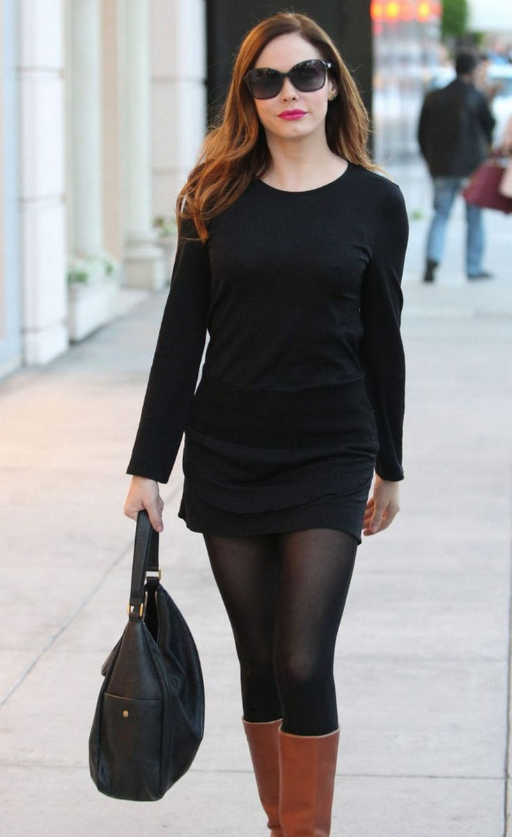 Rose McGowan in black pantyhose, simple cut dress and brown boots