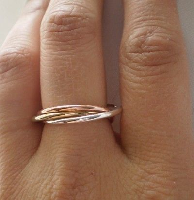 If you can't afford the Cartier Trinity Ring, this one is a beautiful affordable alternative!
